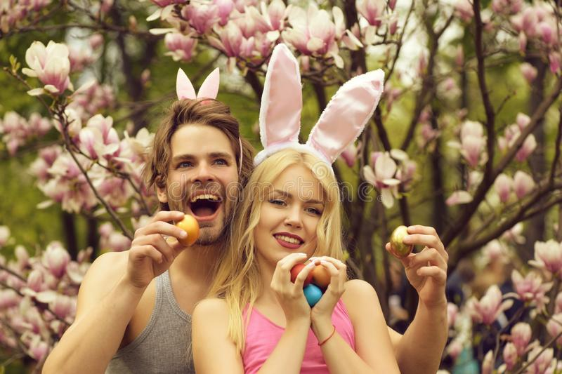 Couple of happy man and girl, easter friends with eggs stock photo