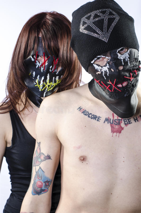 The couple in hardcore masks stock photography