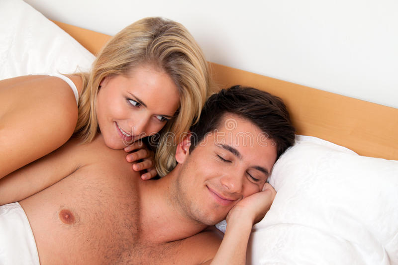 Couple Has Fun In Bed. Laughter, Joy And Eroticism Royalty Free Stock Photos