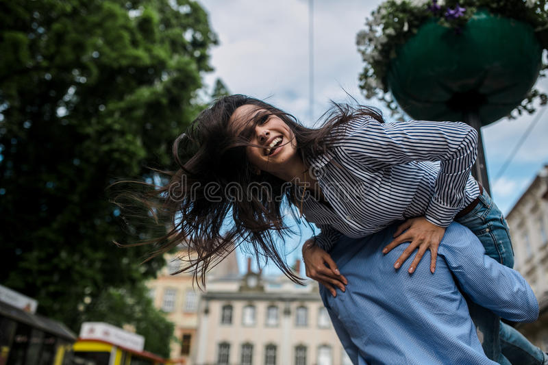 Couple have fun in the city stock images