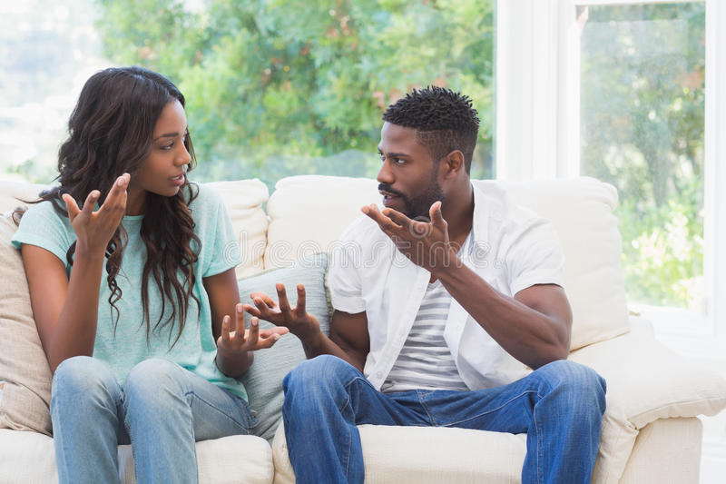 Couple having argument on the couch royalty free stock image