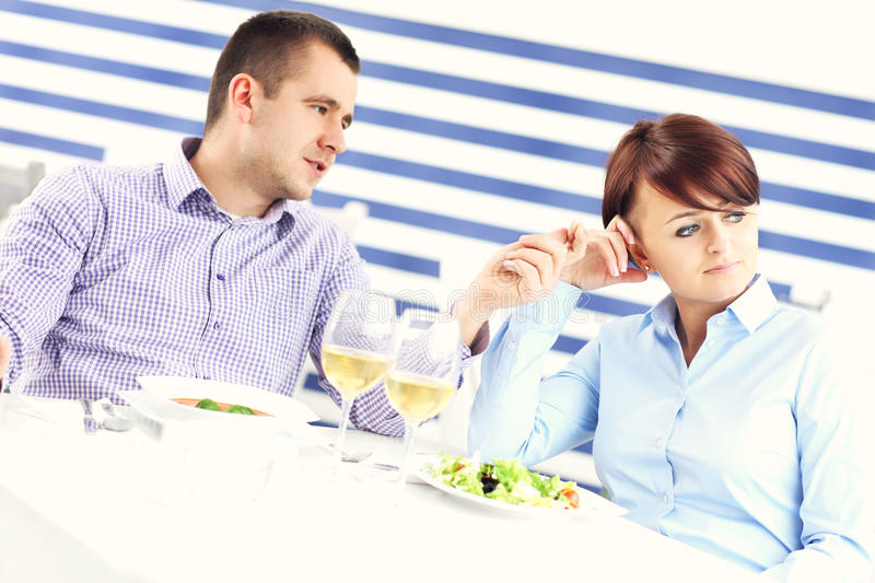 Couple having argument in a restaurant. A picture of a young couple having an argument in a restaurant royalty free stock images