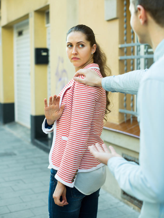 Couple having bad quarrel. On city street in spring day royalty free stock image