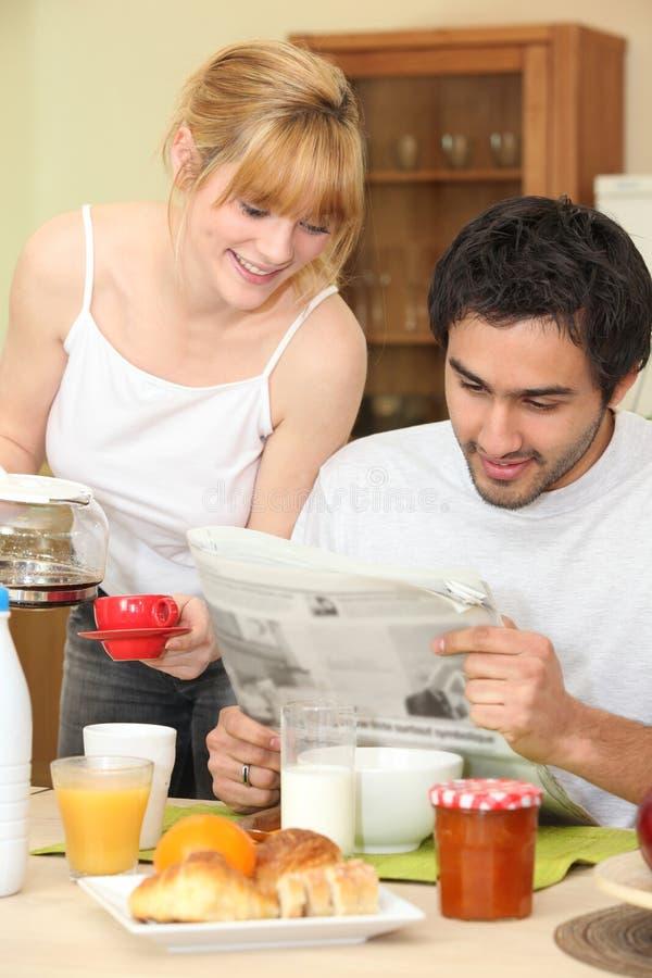 Couple having breakfast stock photography