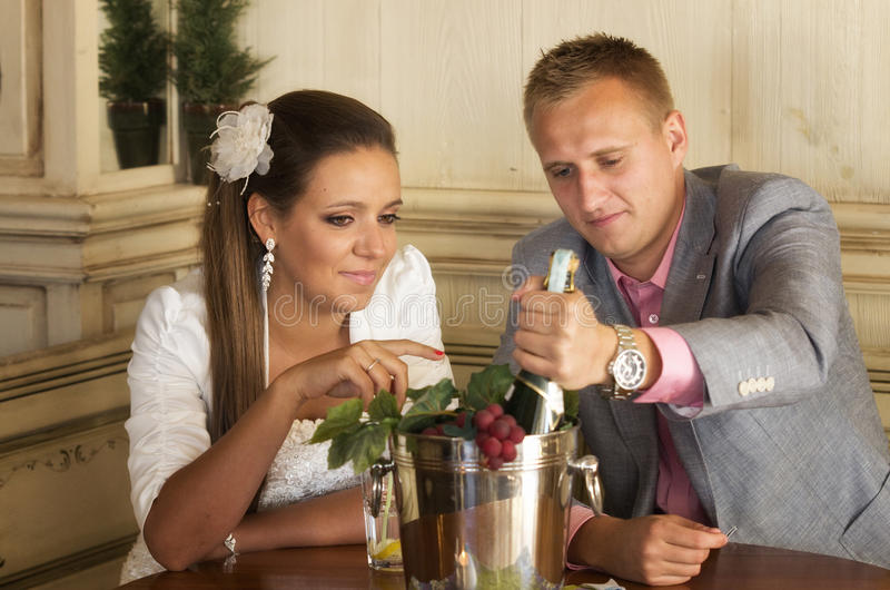 Couple having champagne stock photos