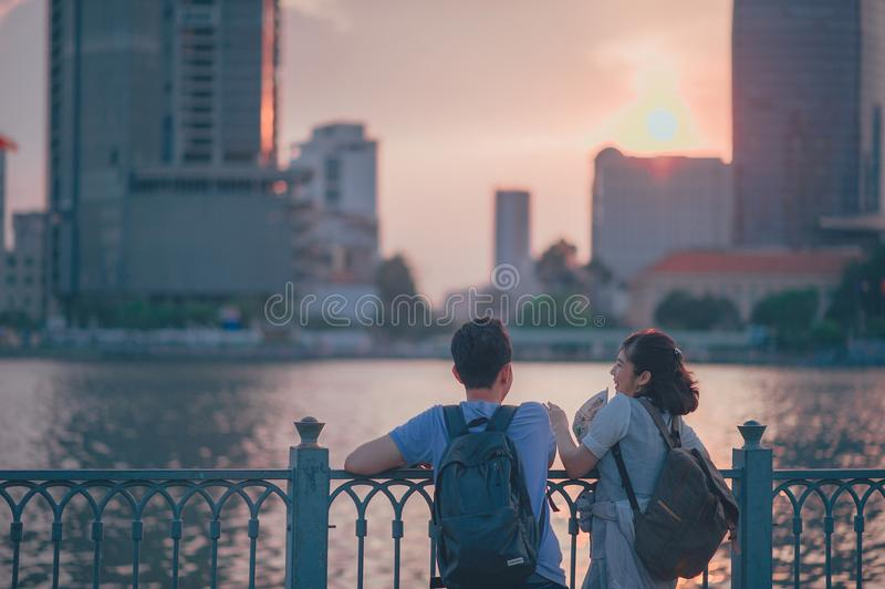 Couple Having Conversion Near Metal Fence during Golden Hour stock images