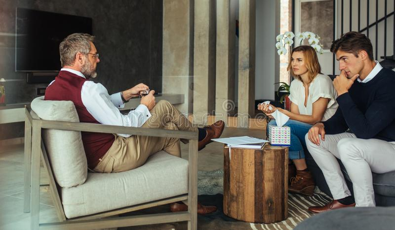 Couple having counseling and psychotherapy session stock images