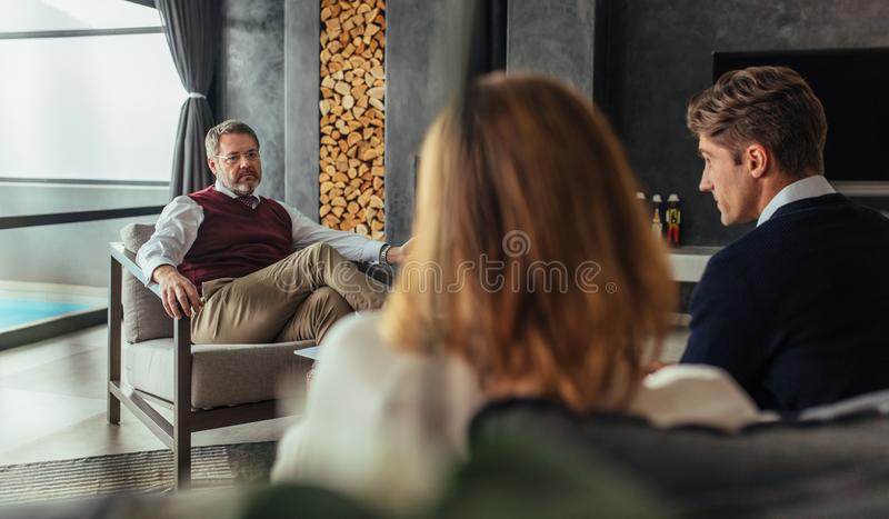 Couple having a counseling session with psychologist royalty free stock photography