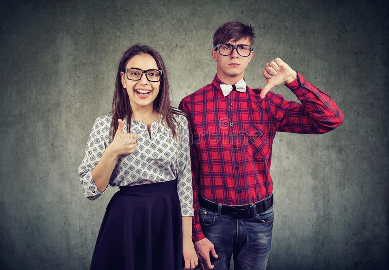 Couple having different attitude to life royalty free stock photography