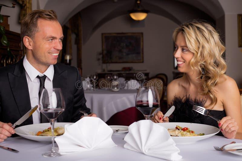 Couple having dinner in restaurant stock photo