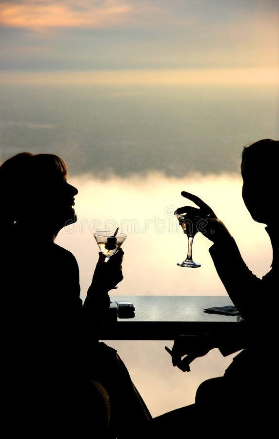 Couple having a drink stock image