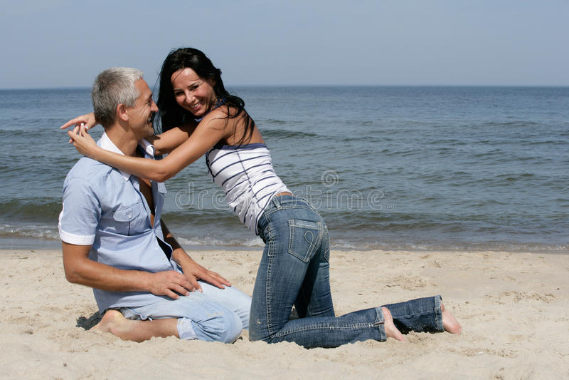 Download Couple Having Fun On The Beach Stock Photo - Image: 11136414