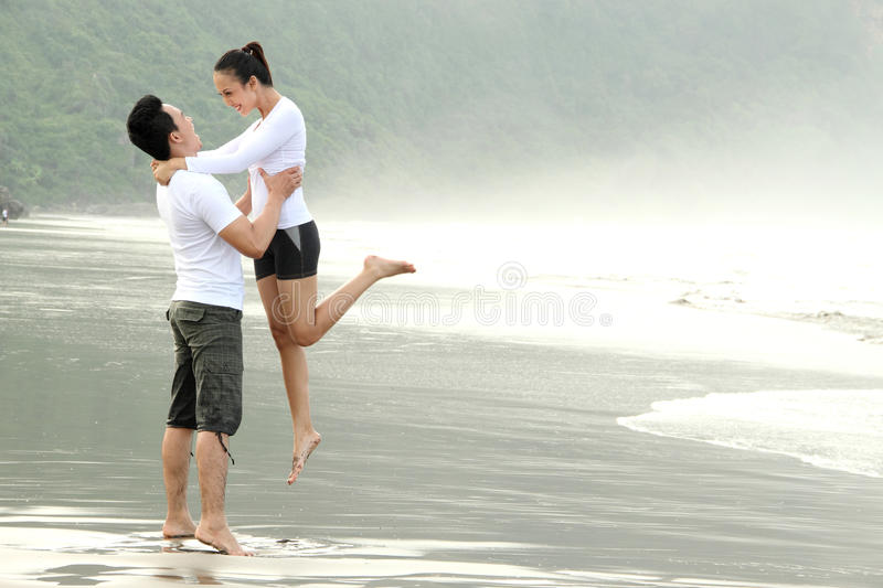 Download Couple Having Fun On The Beach Stock Photo - Image: 24831620