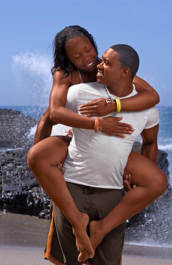 Couple Having fun on beach stock images