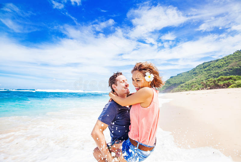 Couple having fun on a beach stock images