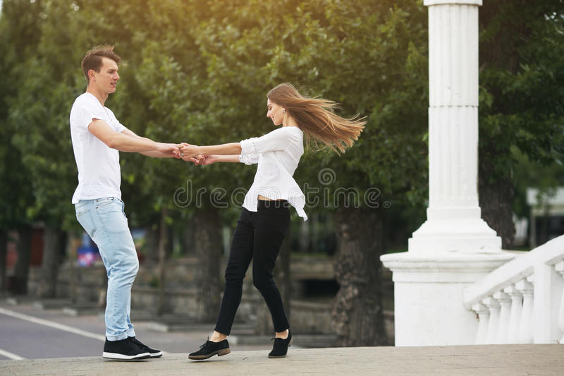 Couple having fun on a bridge in the park royalty free stock image