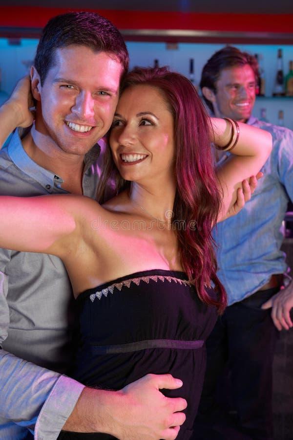 Couple Having Fun In Busy Bar royalty free stock photos