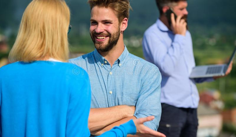 Couple having fun while busy businessman speak on phone. Couple happy flirting while man tense with mobile conversation. Couple having fun while busy businessman royalty free stock photo