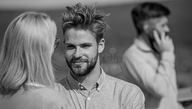 Couple having fun while busy businessman speak on phone. Partners glad to see each other. Face to face conversation. Advantages concept. Couple happy flirting royalty free stock photos