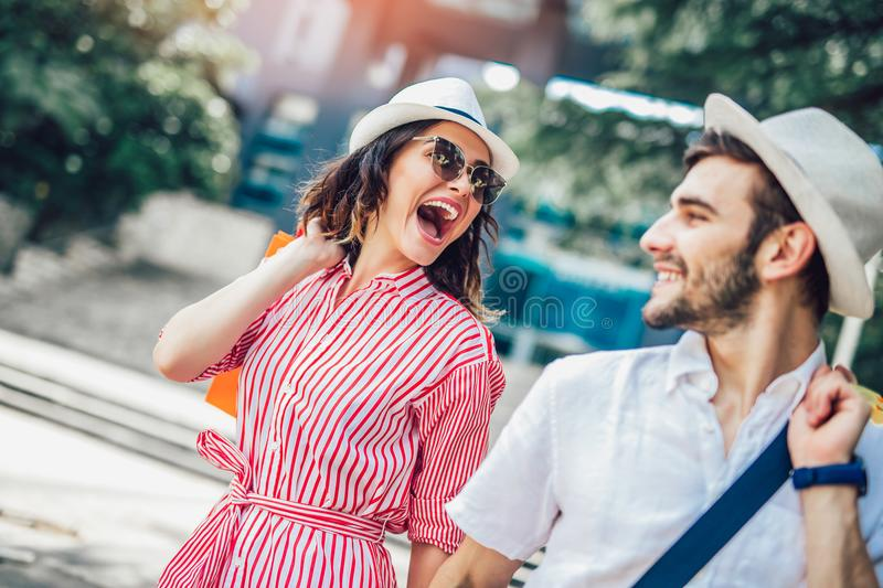 Couple having fun outdoor while doing shopping. Together royalty free stock images