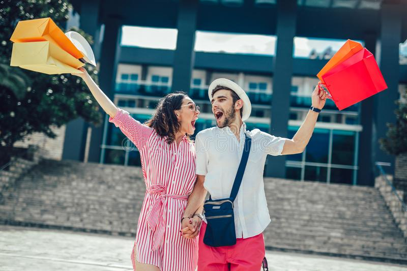 Couple having fun outdoor while doing shopping. Together royalty free stock photography