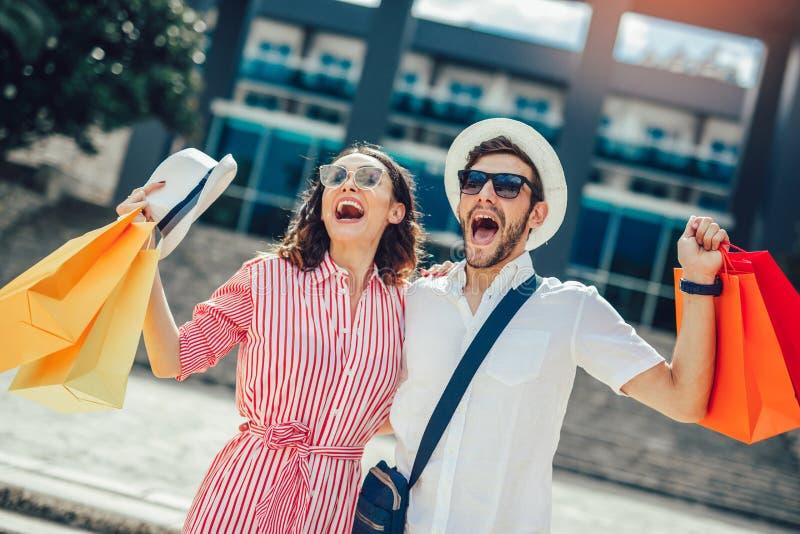 Couple having fun outdoor while doing shopping. Together stock photos