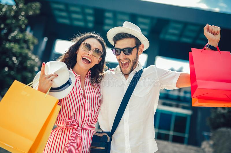 Couple having fun outdoor while doing shopping. Together stock images