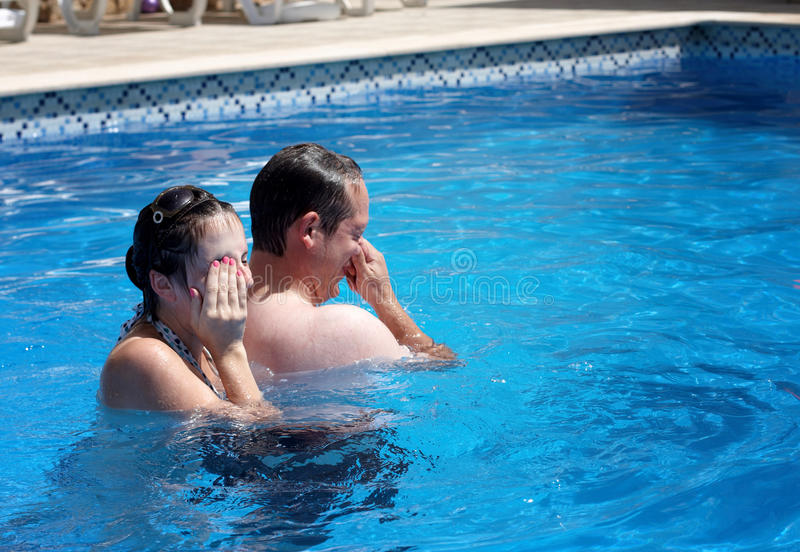A couple having fun in a pool royalty free stock images