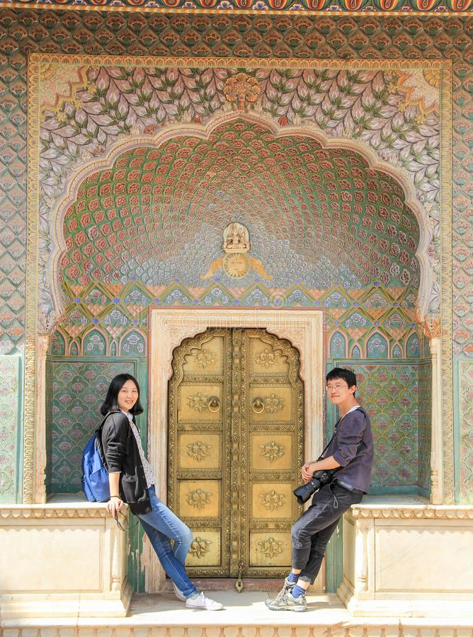 Couple having fun before Rose Gate in City Palace, Jaipur, India. Couple having fun before Rose Gate Winter Gate, located in the City Palace, Jaipur, India royalty free stock photos