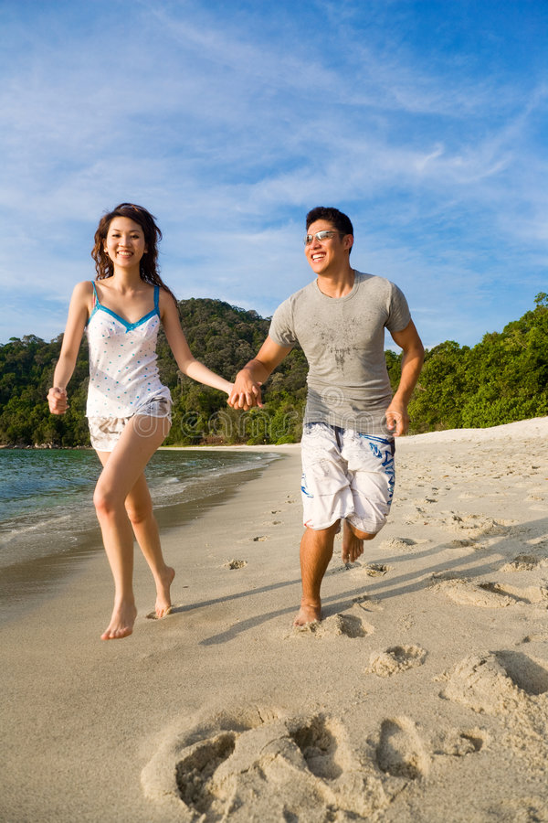Download Couple having fun running stock photo. Image of carefree - 4569056