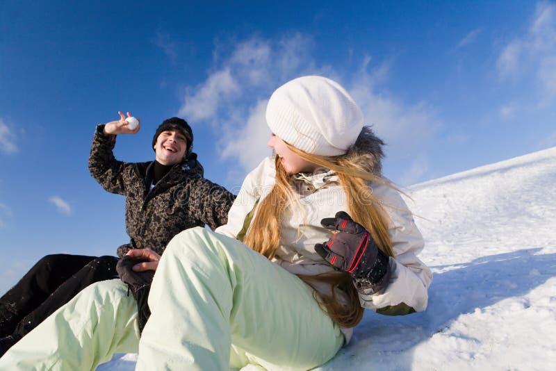 Couple having fun on snowboard stock photos