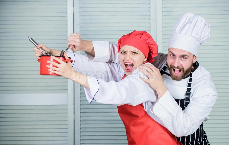 Couple having fun while whipping cream. Cooking healthy meal. Cooking together is more fun. Woman and bearded man chef. Couple having fun while whipping cream stock photography