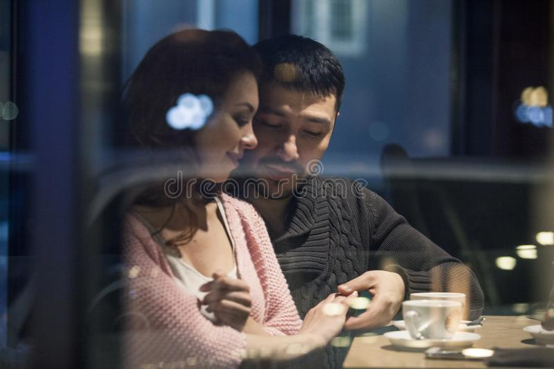 Couple having a good time in a cafe. royalty free stock photography