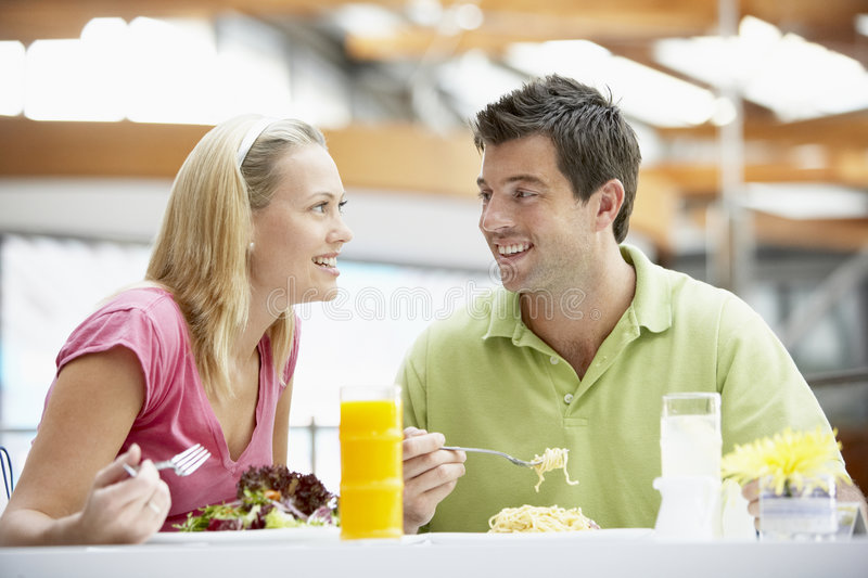 Couple Having Lunch At The Mall Stock Photography