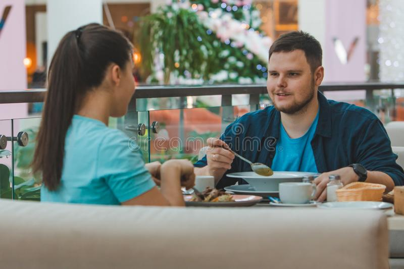 Couple having lunch in mall cafe together. date talking royalty free stock image