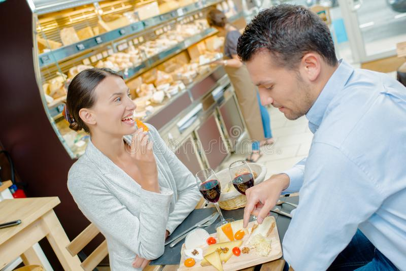 Couple having meal in cafe stock images