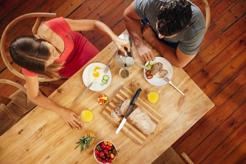 Couple having morning breakfast in kitchen royalty free stock image