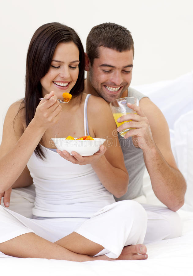 Download Couple Having Nutritive Breakfast In Bed Stock Photo - Image: 11541664