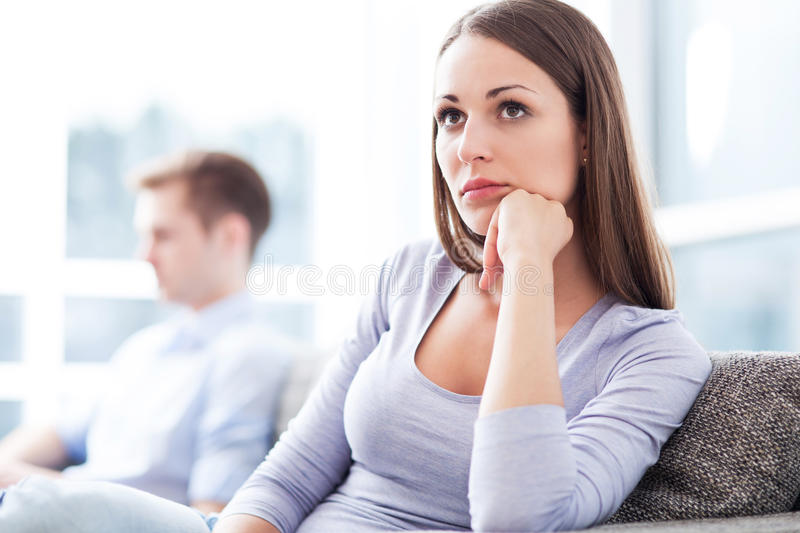 Couple having relationship problems. Couple on sofa having relationship problems stock photos