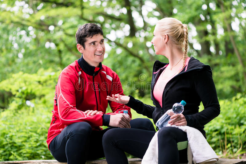 Couple having rest during jogging sport royalty free stock photography