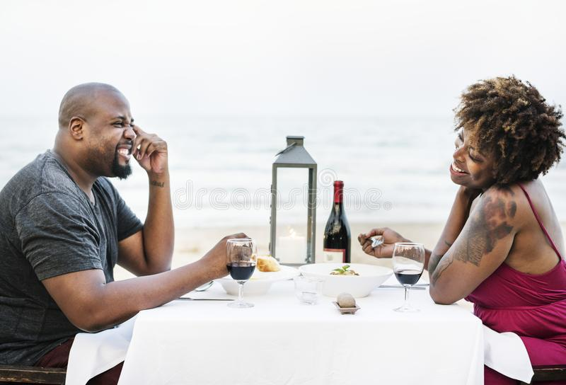 Couple having a romantic dinner at the beach royalty free stock photography