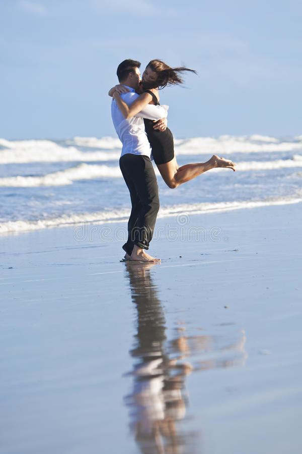 Download Couple Having In Romantic Embrace On Beach Stock Photo - Image: 12415688