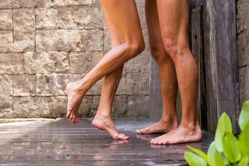 Couple having shower together stock photo