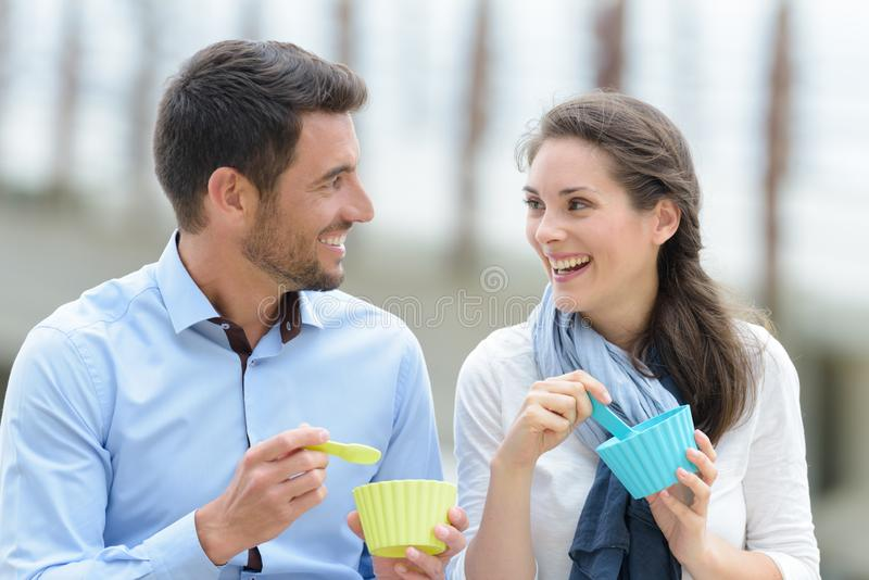 Couple having their snack on silicon cups. Ice stock photography