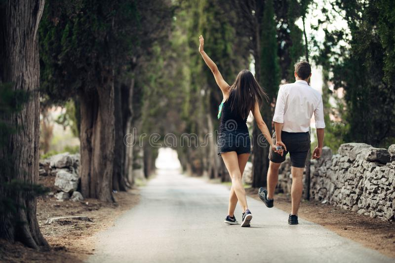 Couple having a walk in nature.Making a company.Stress free,freedom feeling.Happiness and mindfulness.Serene relationship.Soul mat royalty free stock photography