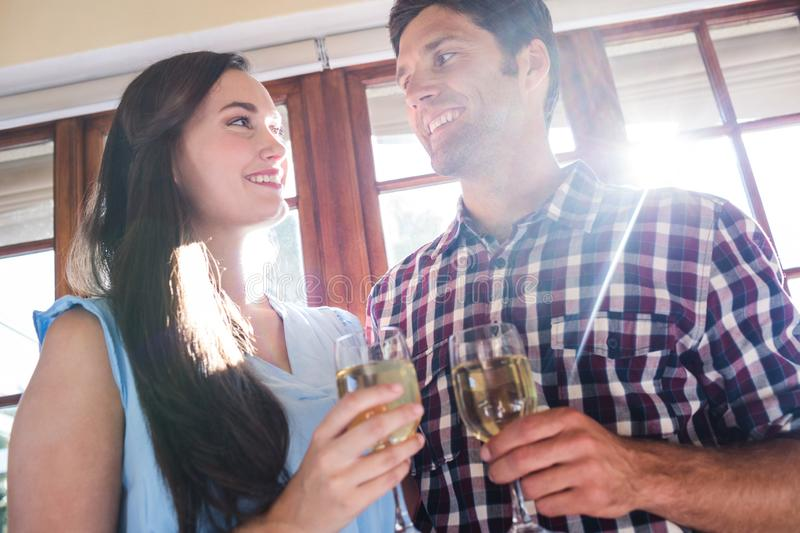 Couple having white wine in restaurant royalty free stock images
