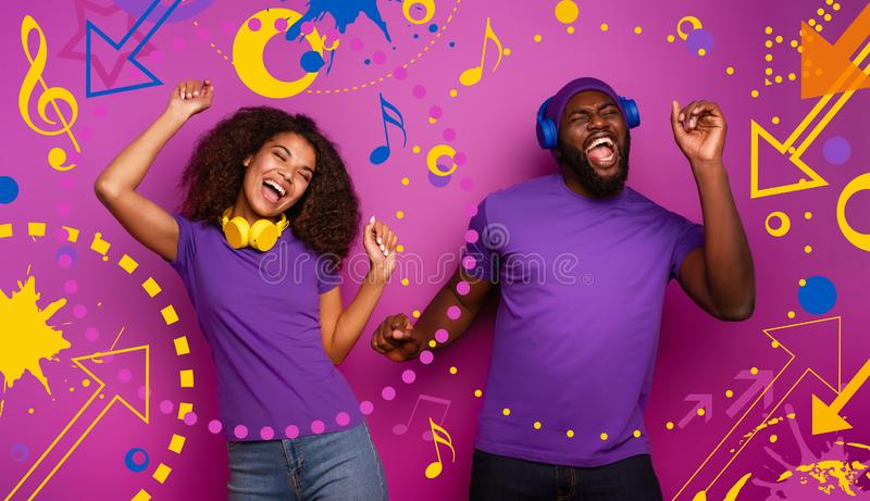 Couple with headset listen to music and dance with energy on violet background with pop shapes. Couple with headset listen to music and dance with energy on royalty free stock image