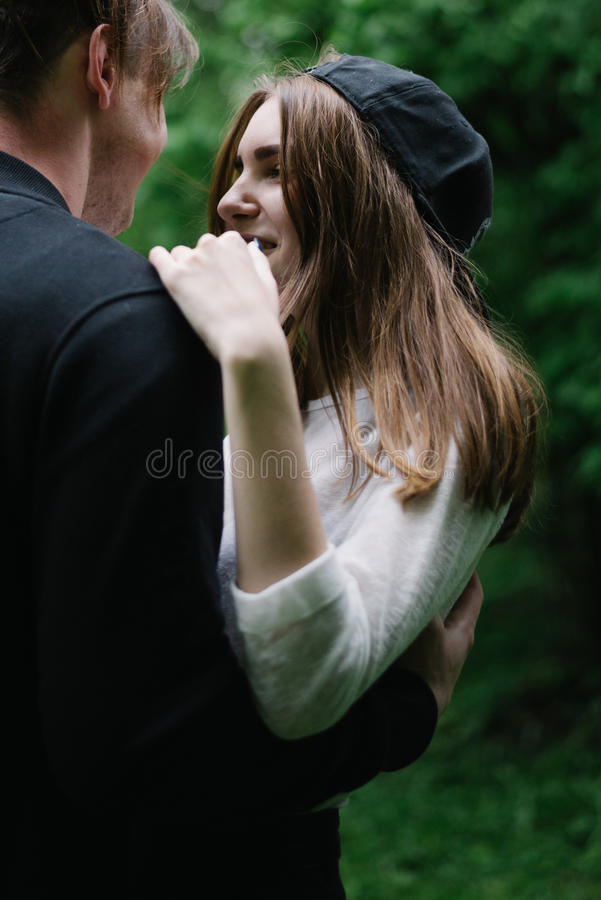 Couple higging in the park stock photos