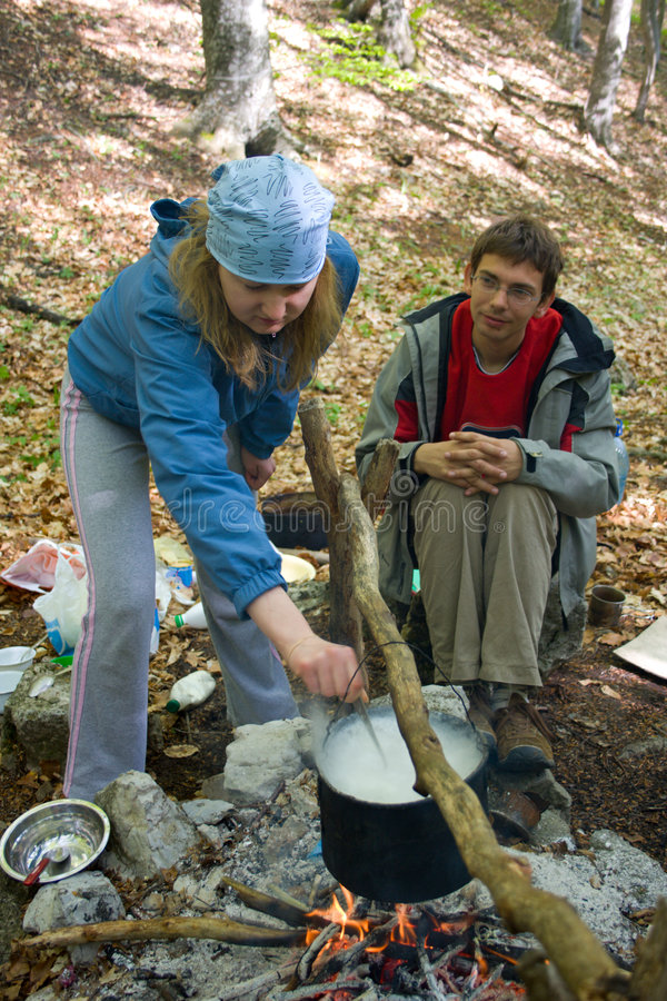 Download Couple Of Hiker Cooking On Fire In Forest Stock Image - Image of outdoor, sitting: 5138413
