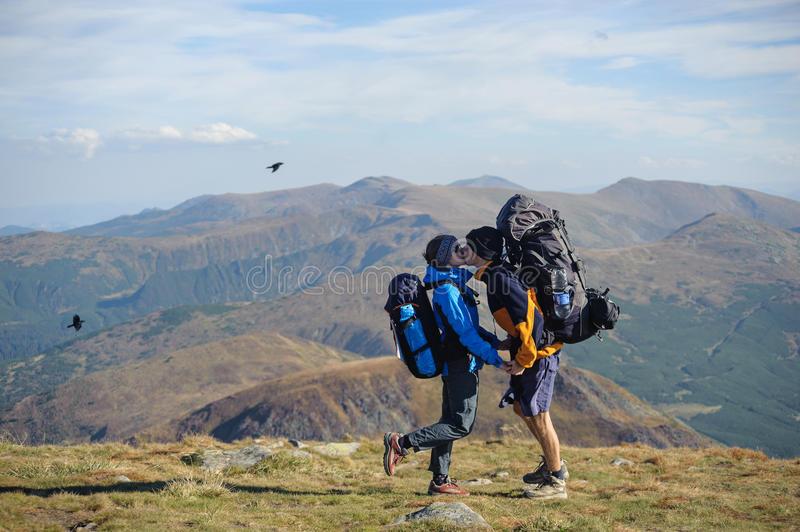 Couple hikers in the Carpathians mountains with backpacks stock photography